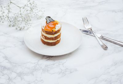 layered dessert on marble table