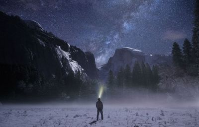 man looking at the night sky