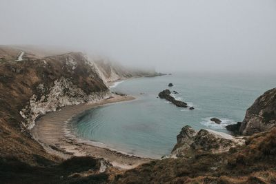foggy view of secluded beach