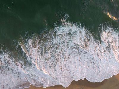 ocean reaching beaching