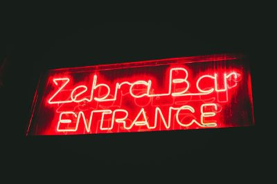 zebra bar neon entrance sign