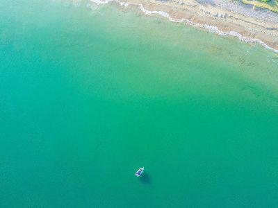 lonely boat in an ocean