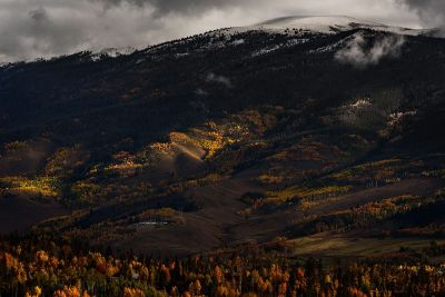 snowcapped mountain and valley in fall