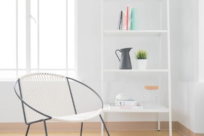 a bookshelf and a chair