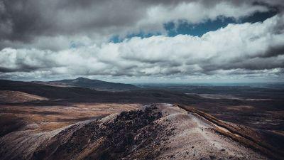 dirt rolling off hillside
