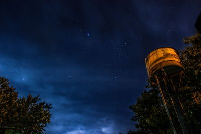 water tower in fleld at night