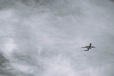 airplane in cloudy sky