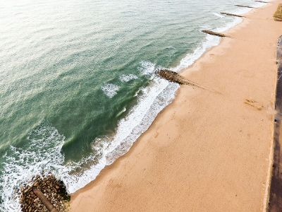 clear beach sand and ocean
