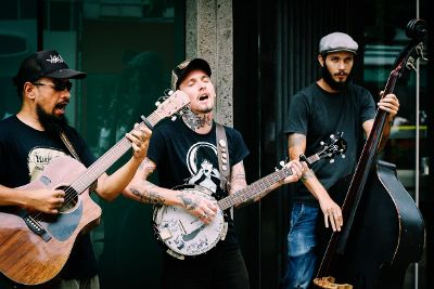 three men playing music
