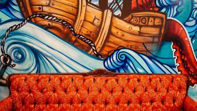 couch amongst sea mural