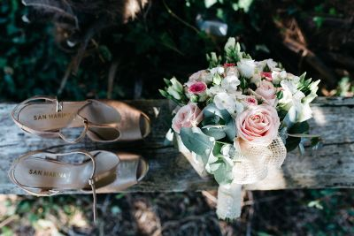 shoes and bouquet on a log