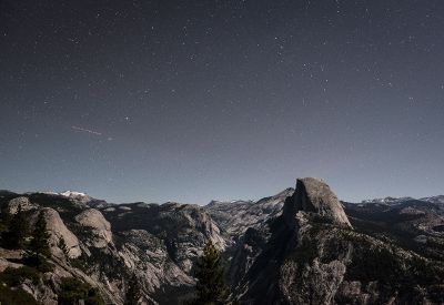 starry sky above rocky terrain