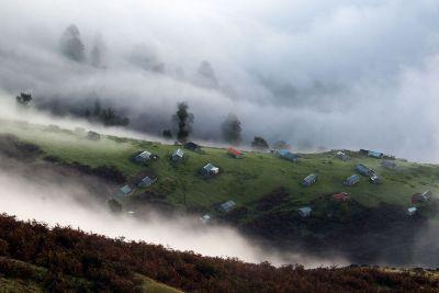 hillside in the clouds