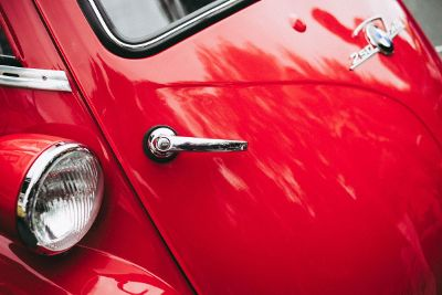 trunk handle on red car