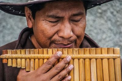 man playing mouth organ