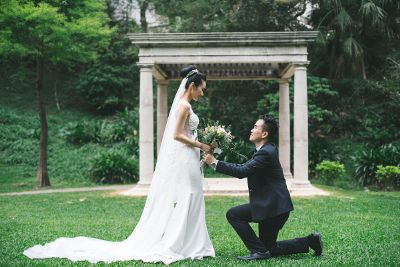 groom down on one knee