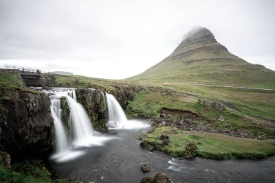 waterfalls and a cloudy mountain spire
