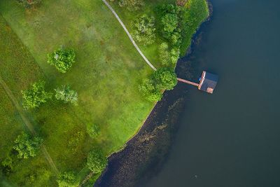 aerial view of house by water