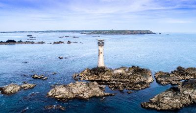 lighthouse on blue water