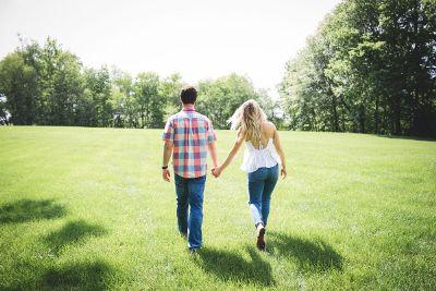 beautiful couple walking in greenery