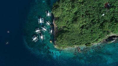 boats on water near island