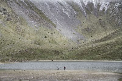 two people at base of mountain