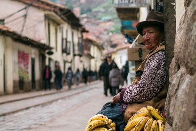 old woman with bananas