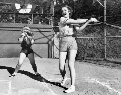 women playing baseball