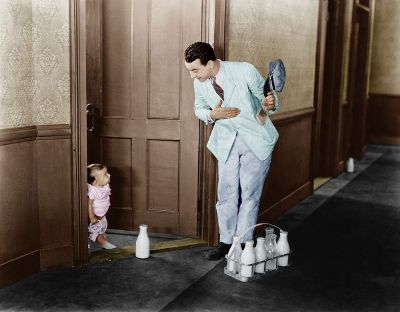 milkman delivering milk to baby