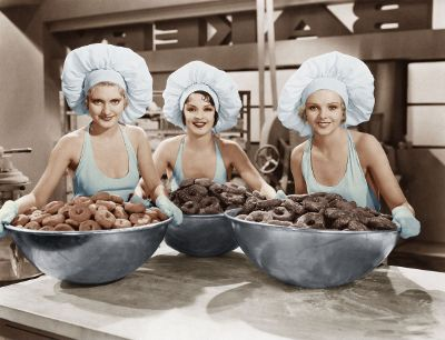women factory workers with donuts