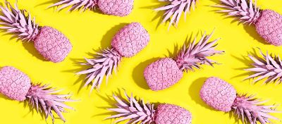 pink pineapples on a yellow background