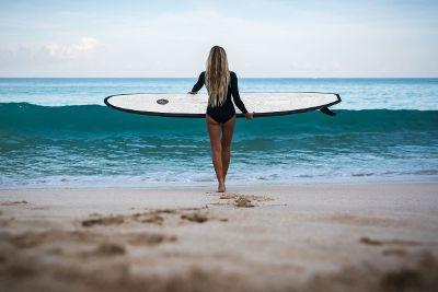 women surfing at beach