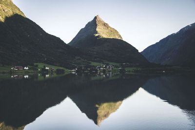 village in mountains by lake