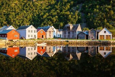 houses next to lake and mountain