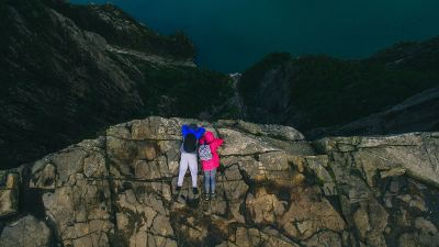two people on rocky cliff