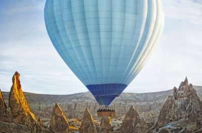 blue hot air balloon in dessert