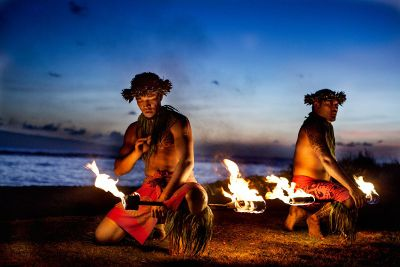 polynesian men with torches